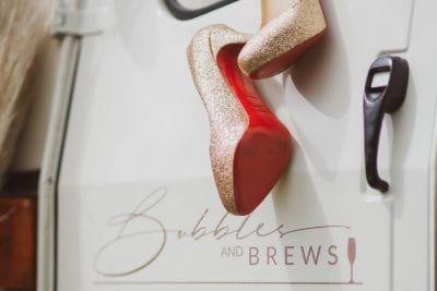 Christian Louboutin Shoes on Bubbles and Brews Prosecco Cart Door