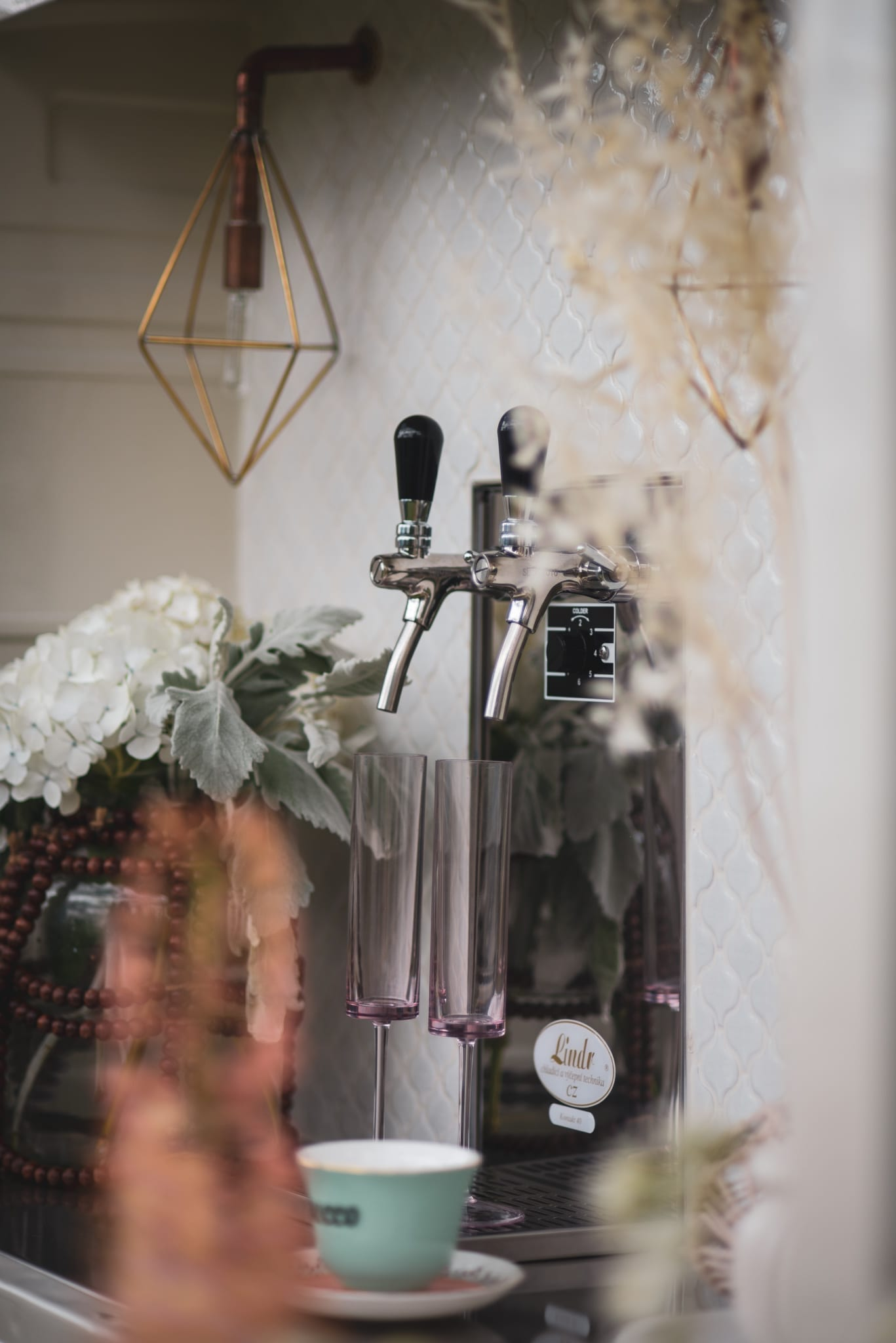 Close Up of Taps on Bubbles and Brews Prosecco Cart